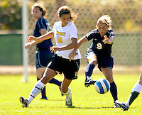 2 September 2007: University of Vermont Catamounts' Gabby Bonfigli (10), a Freshman from Essex Junction, VT, battles Nicole Trickett (9), a Senior from Eugene, OR, during game action against the George Washington University Colonials at Historic Centennial Field in Burlington, Vermont. The Colonials rallied to defeat the Catamounts 2-1 in overtime during the TD Banknorth Soccer Classic...Mandatory Photo Credit: Ed Wolfstein Photo