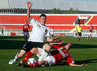 Nils Quaschner (L) of Germany is challenged by Riza Durmisi of Denmark during the UEFA U-17 championships Semi Final match between Denmark and Germany on May 12, 2011 in Novi Sad, Serbia. (Photo by Srdjan Stevanovic/Starsportphoto.com)