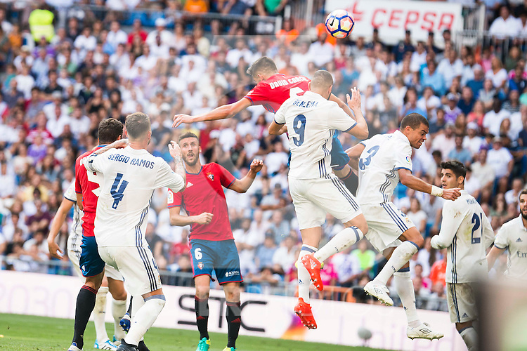 Real Madrid's player Sergio Ramos, Karim Benzema and Pepe and Osasuna's player Goran Causic and Oier Sanjurjo during a match of La Liga Santander at Santiago Bernabeu Stadium in Madrid. September 10, Spain. 2016. (ALTERPHOTOS/BorjaB.Hojas)
