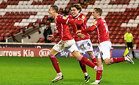 21st November 2020, Oakwell Stadium, Barnsley, Yorkshire, England; English Football League Championship Football, Barnsley FC versus Nottingham Forest; Cauley Woodrow of Barnsley  celebrates 88th minute second goal with Callum Styles of Barnsley  and Mads Juel Andersen of Barnsley