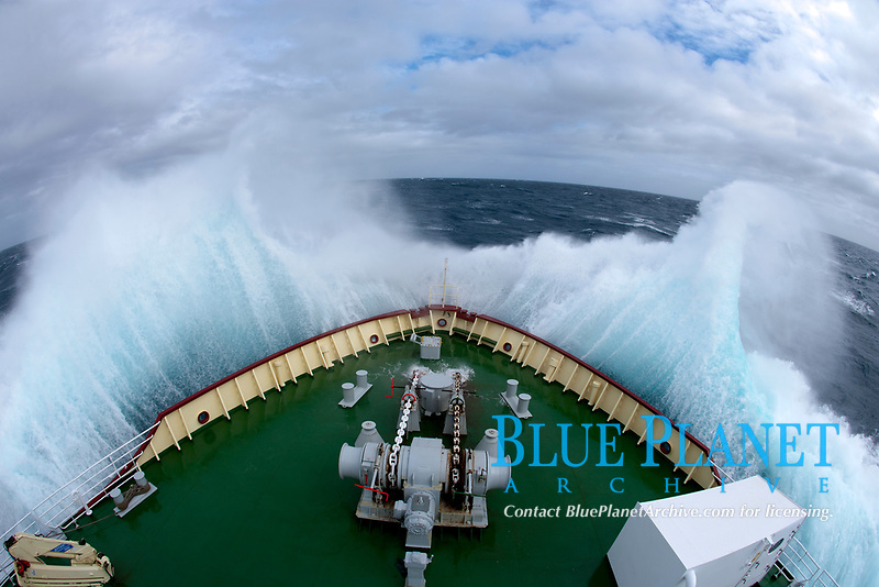 Icebreaker Polar Star, bow plunging through high seas during crossing of the Drake Passage between South America and the Antarctic Peninsula.