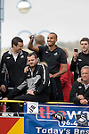 Darren Pratley takes a photo with Swansea City Football Club players and staff celebrating their promotion to the Premier League with an opentop bus tour of the city, where thousands of supporters turned out to show their appreciation..