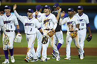 Zach Remillard (7) of the Winston-Salem Dash high fives teammates following their win over the Carolina Mudcats at BB&T Ballpark on June 1, 2019 in Winston-Salem, North Carolina. The Dash defeated the Mudcats 5-4 in game two of a double header. (Brian Westerholt/Four Seam Images)