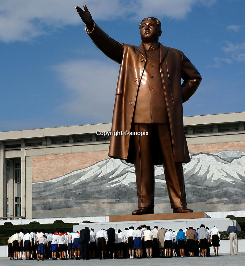 """North Koreans pay homage and bow at the statue of Kim Il-Sung, Pyongyang, North Korea. North Korea is one of the last great dictatorships where, """"Dear Leader"""" Kim-Jong-il and his father Kim Il-sung """"Great Leader"""" are worshipped and there is complete control of a people who are constantly reminded of the evil deeds of the west and USA."""