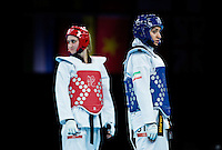 10 AUG 2012 - LONDON, GBR - Sousan Hajipourgoli (IRI) (right) of Iran and  Carmen Marton (AUS) (left) of Australia wait for the referees decision after an appeal during their women's -67kg category preliminary round contest at the London 2012 Olympic Games Taekwondo at Excel in London, Great Britain .(PHOTO (C) 2012 NIGEL FARROW)