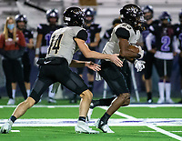 Lawson Gunn (14) of Little Rock Central hands ball off to Sam Franklin (23) at Harmon Stadium, Fayetteville, Arkansas on Friday, November 13, 2020 / Special to NWA Democrat-Gazette/ David Beach