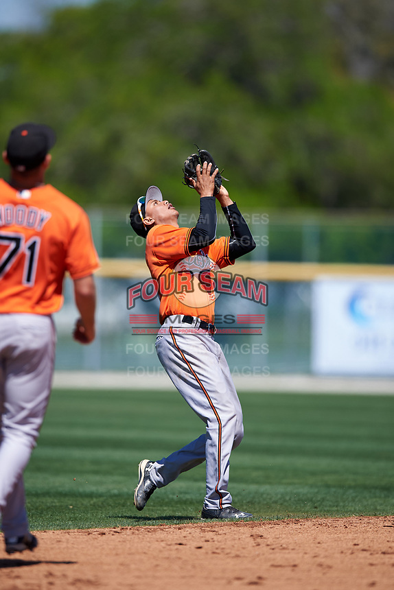 Baltimore Orioles Irving Ortega (26) tracks a pop up during a minor league Spring Training game against the Minnesota Twins on March 17, 2017 at the Buck O'Neil Baseball Complex in Sarasota, Florida.  (Mike Janes/Four Seam Images)