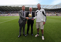 Pictured: Groundsman Dan Duffy (R) with his Premier League Award for the Liberty Stadium pitch, chairman Huw Jenkins (L). Sunday 04 May 2013<br /> Re: Barclay's Premier League, Swansea City FC v Fulham at the Liberty Stadium, south Wales.