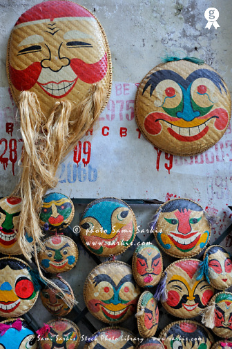Vietnamese bamboo masks for sale, on wall (Licence this image exclusively with Getty: http://www.gettyimages.com/detail/100378206 )