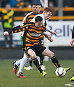 Alloa's Kevin Cawley holds off Hib's Fraser Fyvie.