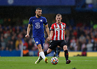 2nd October 2021; Stamford Bridge, Chelsea, London, England; Premier League football Chelsea versus Southampton; Mateo Kovacic of Chelsea passing the ball into midfield while being marked by Nathan Redmond of Southampton