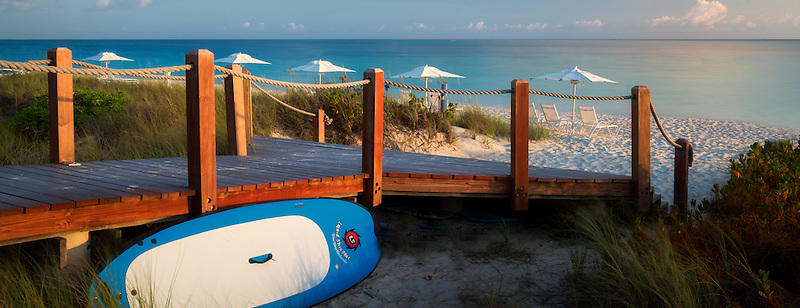 Pathway to ocean with surf bard and beach umbrellas. Turks and Caicos. Providenciales.