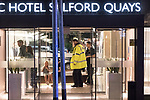 © Joel Goodman - 07973 332324 . 10/08/2017. Salford, UK. Police and bystanders in the foyer of the Marriott Hotel which is next door to and shares a car park with the Ibis Hotel .  The scene at the Ibis hotel in Salford Quays where a young boy was killed in a collision with a car earlier this evening (Thursday 10th August 2017) . Photo credit : Joel Goodman