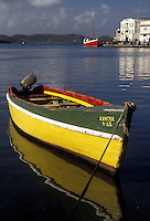 "AJ2531, Grenada, Caribbean, St. George's, Caribbean Islands, Green and yellow fishing boat reflects in the calm waters on the harbor of St. George's the capital city of the island of Grenada """"the spice isle"""" (a British Commonwealth member)."
