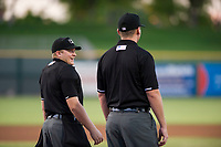 Home plate umpire West Hyer jokes with base umpire Pete Talkington prior to a game between the AZL Rangers and the AZL Giants on August 22 at Scottsdale Stadium in Scottsdale, Arizona. AZL Rangers defeated the AZL Giants 7-5. (Zachary Lucy/Four Seam Images via AP Images)