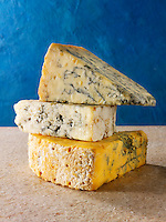 English blue cheese wedges - stilton, white stilton amd blacksticks