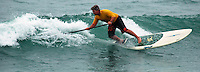 Saturday, June 14, 2008, Tourmaline Surf Park, Pacific Beach, San Diego, CA, USA.  Kevin Coffman competes in the Stand-Up Paddle competition during the Pacific Beach Surf Club's Tenth Annual Longboard Classic at Tourmaline Surfing Park.  The event was well attended despite gray, June gloom clouds and fickle, windy surf conditions.