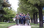 Escorted by Carson City Sheriff's deputies, Las Vegas Metropolitan Police officers Zack Beal, Tina Ellison and Mike Bland bring the memorial batons into the annual Nevada Law Enforcement Officers Memorial Ceremony on the Capitol Mall in Carson City, Nev., on Thursday, May 7, 2015.<br /> Photo by Cathleen Allison
