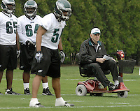 Philadelphia Eagles Defensive Coordinator Jim Johnson, right, runs defensive drills from his wheelchair as the team conducts the first mini-camp of the season for all rookies and veterans at the team's Nova-Care Complex Friday, May 1, 2009, in Philadelphia. (AP Photo/Bradley C Bower)