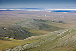 The last foothills of the Brooks Range give way to the Artic Plains and the Arctic Ocean beyond.
