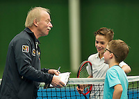 Almere, Netherlands, December 6, 2015, Winter Youth Circuit, Umpire does the toss in a junior match<br /> Photo: Tennisimages/Henk Koster