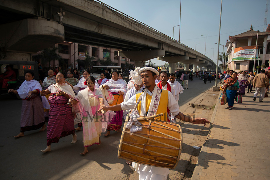 India - Manipur - Imphal - Vendors from the Ima Market and traditional musicians dance in the street to honour the gods of the market who protect the vendors and bring them good luck in business.