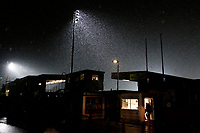 Snow falls pre match during the Sky Bet League 1 match between AFC Wimbledon and Fleetwood Town at the Cherry Red Records Stadium, Kingston, England on 22 January 2019. Photo by Carlton Myrie / PRiME Media Images.