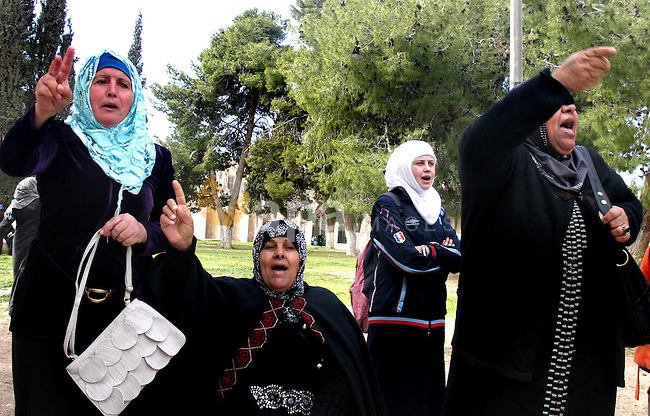 Palestinian women protest, while Jewish settlers entered the Al-Aqsa mosque compound in Jerusalem's Old City on February 23, 2012.A Palestinian resident of Jerusalem's Old City who was at the site during the incident, told that a group of Jewish settlers entered the compound. Among them, Palestinians identified religious Jews and began hurling stones at police.  Photo by Mahfouz Abu Turk