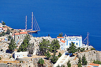 Churches above the port of Symi island, Greece