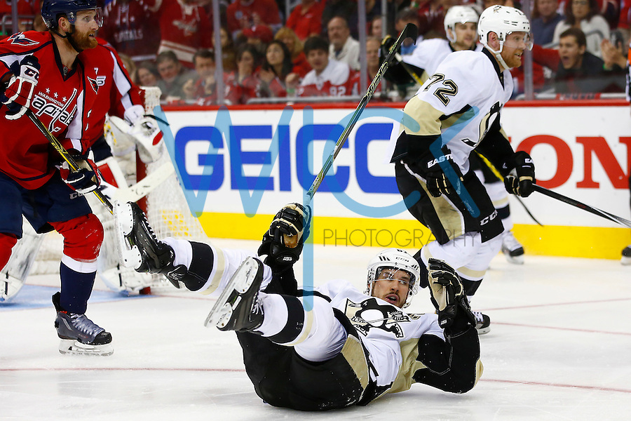 Sidney Crosby #87 of the Pittsburgh Penguins falls to the ice in front of the goal in the third period against the Washington Capitals during game two of the second round of the Stanley Cup Playoffs at Verizon Center in Washington D.C. on April 30, 2016. (Photo by Jared Wickerham / DKPS)