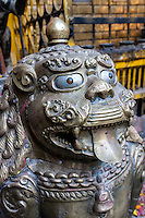 Nepal, Patan.  Temple Guardian Lion, Golden Temple (Kwa Baha).