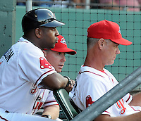 July 29, 2009: Hitting coach Billy McMillon, left, manager Kevin Boles, center, and pitching coach Bob Kipper of the Greenville Drive watch the game from the dugout at Fluor Field at the West End in Greenville, S.C. Photo by: Tom Priddy/Four Seam Images