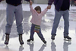 Ice Skater Cailene Curran (3) gets a helpful hand to get around the Holiday Ice Rink at Embarcadero Center in San Francisco, California.