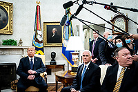 United States President Donald J. Trump and Polish President†Andrzej Duda during a bilateral meeting in the Oval Office of the White House in Washington, DC on June 24, 2020. From left to right: President Trump, US Vice President Mike Pence, US Secretary of State Mike Pompeo.<br /> Credit: Erin Schaff / Pool via CNP/AdMedia