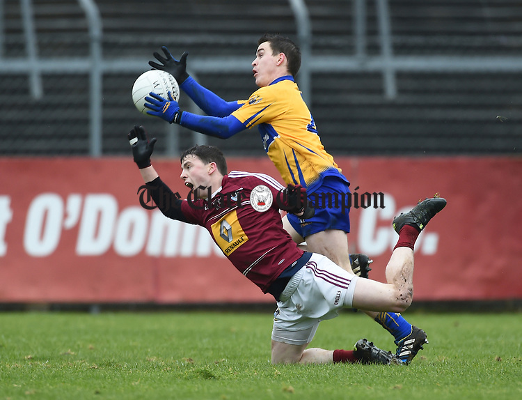 John Connellan of Westmeath in action against Martin Mc Mahon of Clare during their league game in Cusack Park. Photograph by John Kelly.