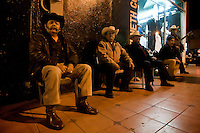 """Trios waiting on a corner to be picked up by some """"party clients"""".<br /> <br /> In northern mexico bands known as """"trios"""" are well known for their services, private playings. In restaurants, bars or in the street is often see them offering songs, from traditional mexican music like mariachis, banda, corridos to classic rock."""