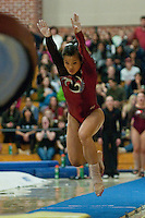 STANFORD, CA-JANUARY 22, 2012 - Ivana Hong executes her vault en route to Stanford's win over the visiting University of Washington Gym Dawgs at Burnham Pavilion on the Stanford Campus.
