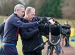 David Weir examining footage from training to decide who is winning