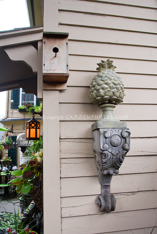 Old wooden welcome pineapple antique ornament on house wall garden, birdhouse