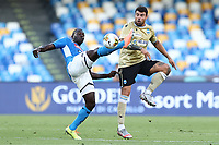 Kalidou Koulibaly of Napoli and Andrea Petagna of SPAL compete for the ball<br /> during the Serie A football match between SSC  Napoli and SPAL at stadio San Paolo in Naples ( Italy ), June 28th, 2020. Play resumes behind closed doors following the outbreak of the coronavirus disease. <br /> Photo Cesare Purini / Insidefoto