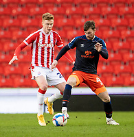 20th February 2021; Bet365 Stadium, Stoke, Staffordshire, England; English Football League Championship Football, Stoke City versus Luton Town; Ryan Tunnicliffe of Luton Town under pressure from Sam Clucas of Stoke City