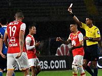 BOGOTA - COLOMBIA - 25-03-2017: Ulises Arrieta, (Der.), arbitro, muestra tarjeta roja a Henry Rojas (Fuera de Cuadro), jugador de Millonarios, durante partido aplazado de la fecha 2 entre Independiente Santa Fe y Millonarios, por la Liga Aguila I-2017, en el estadio Nemesio Camacho El Campin de la ciudad de Bogota. / Ulises Arrieta, (R), referee, shows red card to Henry Rojas (Out of Frame) player of Millonarios, during a postponed match of the date 2 between Independiente Santa Fe and Millonarios, for the Liga Aguila I -2017 at the Nemesio Camacho El Campin Stadium in Bogota city, Photo: VizzorImage / Luis Ramirez / Staff.