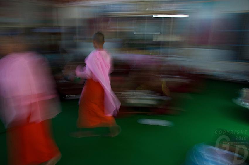 Buddhist Nus serving in the Monastery Village of Kyauk Se near Mandalay, Myanmar