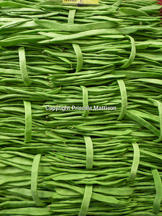 Closeup of neatly stacked green beans.