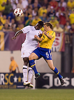 Edson Buddle (14) of the USMNT goes up for a header against Lucas (5) of Brazil during an international friendly at the New Meadowlands Stadium in East Rutherford, NJ. Brazil defeated the USMNT, 2-0.
