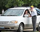 Aug. 19, 2011; Ushers direct move-in traffic...Photo by Matt Cashore/University of Notre Dame