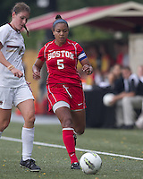 Boston University forward/midfielder Tiya Gallegos (5) brings the ball forward. After 2 complete overtime periods, Boston College tied Boston University, 1-1, after 2 overtime periods at Newton Soccer Field, August 19, 2011.