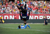 Manchester United midfielder Nani (17) does a backflip after scoring Manchester United's third goal as Chicago Fire goalkeeper Jon Conway (1) lays on the ground in the background.  Manchester United defeated the Chicago Fire 3-1 at Soldier Field in Chicago, IL on July 23, 2011.