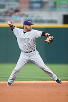 Louisville Bats shortstop Eugenio Suarez (7) makes a throw to first base against the Charlotte Knights at BB&T BallPark on May 12, 2015 in Charlotte, North Carolina.  The Knights defeated the Bats 4-0.  (Brian Westerholt/Four Seam Images)