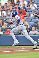 Chicago Cubs center fielder Dexter Fowler (24) runs to first during a game against the Atlanta Braves on July 18, 2015 in Atlanta, Georgia. The Cubs defeated the Braves 4-0. (Tony Farlow/Four Seam Images)